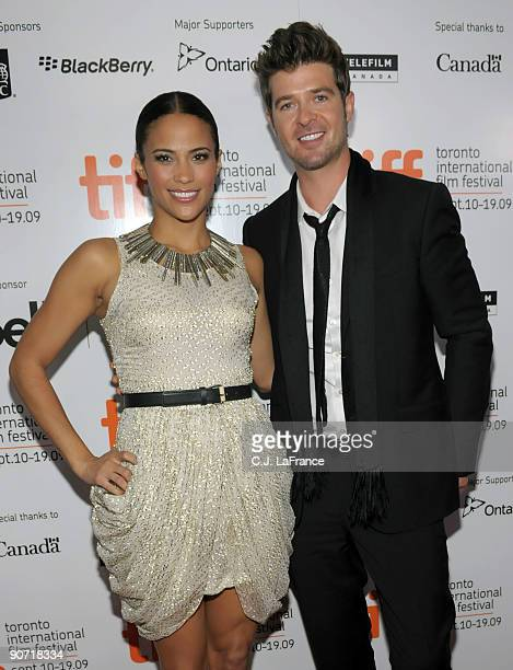 Actress Paula Patton and singer Robin Thicke arrive at the Precious Based on the Novel Push by Sapphire screening introduction during the 2009...