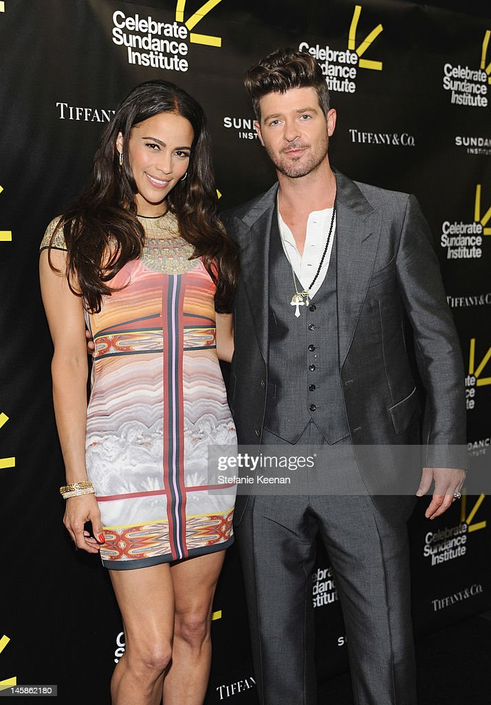 Actress Paula Patton and singer Robin Thicke arrive at the Sundance Institute Benefit presented by Tiffany & Co. in Los Angeles held at Soho House on June 6, 2012 in West Hollywood, California.