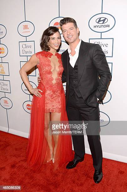 Actress Paula Patton and singer Robin Thicke attend the 56th annual GRAMMY Awards PreGRAMMY Gala and Salute to Industry Icons honoring Lucian Grainge...