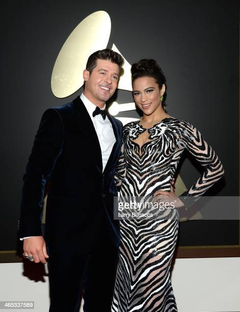Actress Paula Patton and singer Robin Thicke attend the 56th GRAMMY Awards at Staples Center on January 26 2014 in Los Angeles California