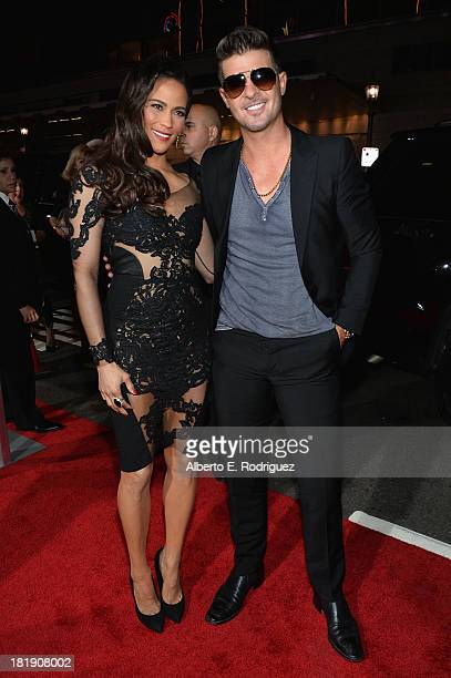 Actress Paula Patton and singer Robin Thicke attend the premiere of Fox Searchlight Pictures' Baggage Claim at Regal Cinemas LA Live on September 25...