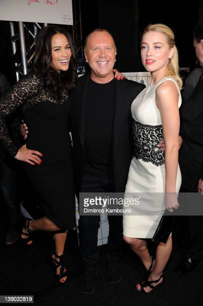 Actress Paula Patton designer Michael Kors and Amber Heard pose backstage at the Michael Kors Fall 2012 fashion show during MercedesBenz Fashion Week...