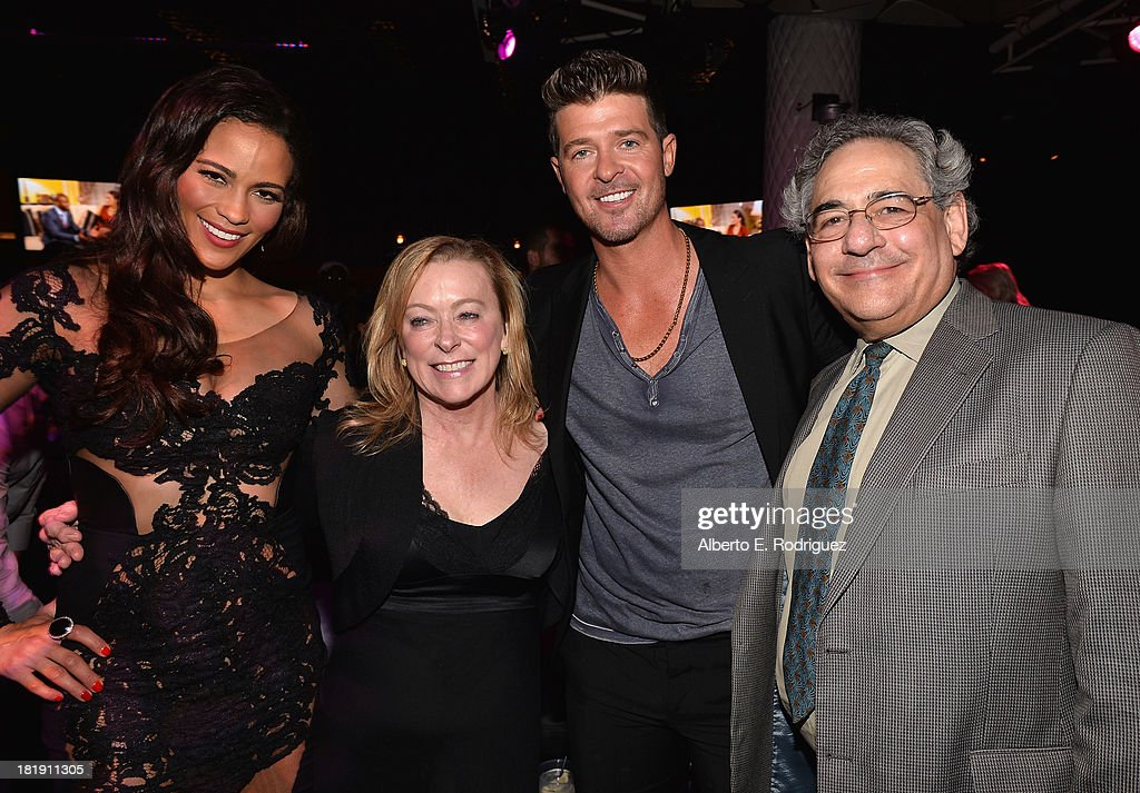 Actress Paula Patton, Fox Searchlight co-president Nancy Utley, singer Robin Thicke and Fox Searchlight co-president Stephen Gilula attend the after party for the premiere of Fox Searchlight Pictures' 'Baggage Claim' at the Conga Room on September 25, 2013 in Los Angeles, California.
