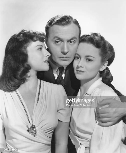Actress Paulette Goddard Charles Boyer and Olivia de Havilland in a scene from the movie Kitty
