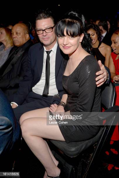 Actress Pauley Perrette and Thomas Arklie attend the 55th Annual GRAMMY Awards at STAPLES Center on February 10 2013 in Los Angeles California