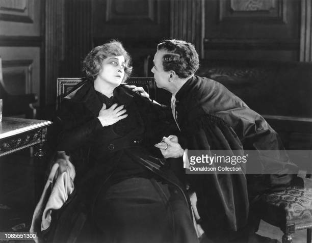 Actress Pauline Frederick and Casson Ferguson in a scene from the movie 'Madame X'