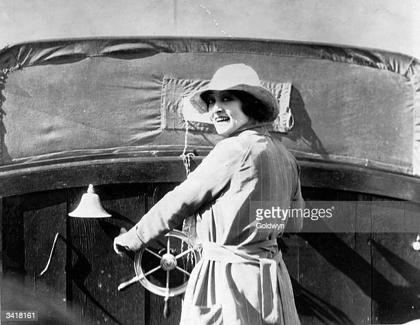 Actress Pauline Frederick driving the motor launch which appears in her latest film 'Bonds of Love'