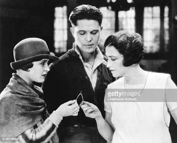 Actress Pauline Frederick pulls on a wishbone in a scene from an early silent film Hollywood California late 1910s