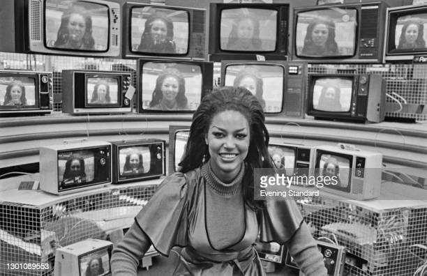 Actress Pauline Peart poses against a bank of television screens, UK, 26th June 1973. She starred in the films 'Carry on Girls' and 'The Satanic...
