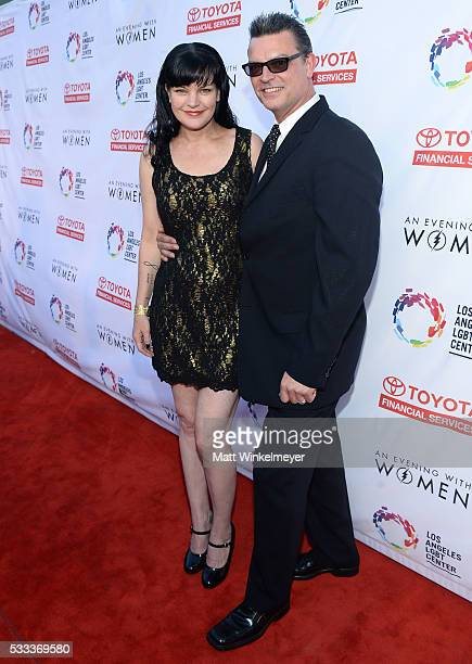 Actress Pauly Perrette and model Thomas Arklie attend An Evening with Women benefiting the Los Angeles LGBT Center at the Hollywood Palladium on May...