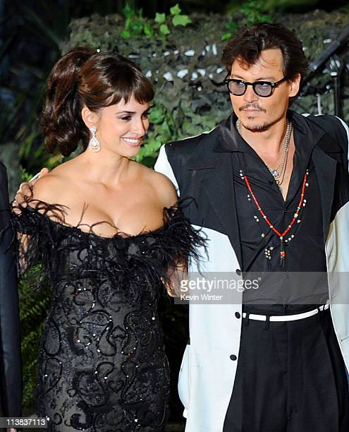 """Actress Penelope Cruz and actor Johnny Depp arrive at premiere of Walt Disney Pictures' """"Pirates of the Caribbean: On Stranger Tides"""" held at..."""