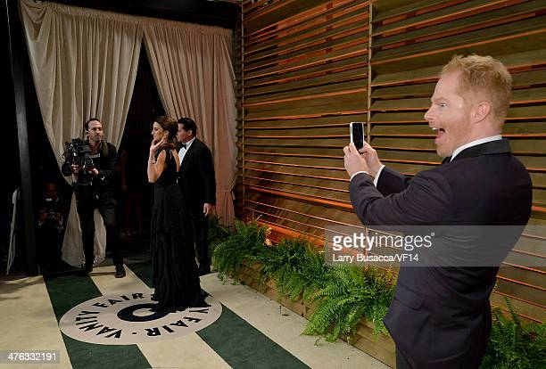 Actress Penelope Cruz and actorJesse Tyler Ferguson attend the 2014 Vanity Fair Oscar Party Hosted By Graydon Carter on March 2 2014 in West...