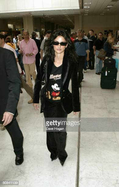 Actress Penelope Cruz arrives at Nice airport for the 57th Annual Cannes Film Festival on May 15 2004 in Cannes France