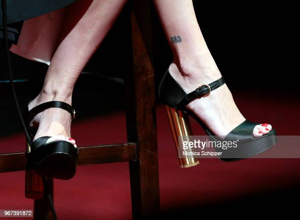 Actress Penelope Cruz shoe detail speaks on stage during SAGAFTRA Foundation Conversations The Assassination Of Gianni Versace American Crime Story...