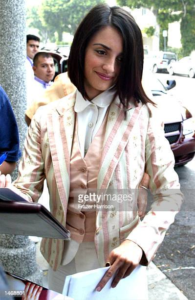Actress Penelope Cruz signs autographs after arriving for a news conference to launch the US branch of the SABERA Foundation on October 10 2002 in...