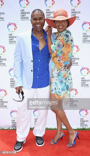 Actress Penny Johnson and husband Gralin Jerald arrive at the GLEH/Los Angeles LGBT Center's Garden Party on July 27 2014 in Los Angeles California