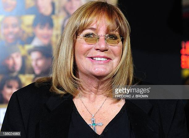 Actress Penny Marshall poses on arrival for the film premiere of 'New Year's Eve' at Grauman's Chinese Theater in Hollywood on December 5 2011 The...