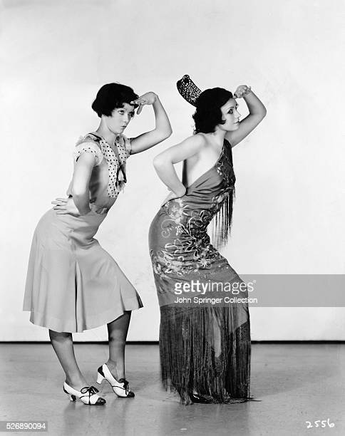 Actress Penny Singleton and Spanish dancer Conchita Montenegro exchange lessons in dancing