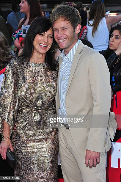 Actress Perrey Reeves and Aaron Fox arrive at the Premiere Of Columbia Pictures' 22 Jump Street at Regency Village Theatre on June 10 2014 in...