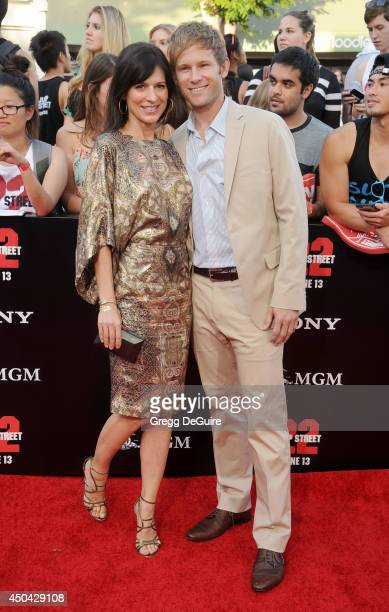 Actress Perrey Reeves and guest arrive at the Los Angeles premiere of 22 Jump Street at Regency Village Theatre on June 10 2014 in Westwood California