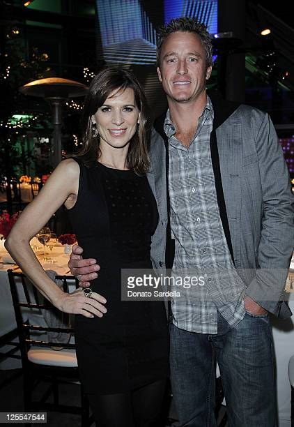 Actress Perrey Reeves and John Musser attend Vogue Dinner Celebrating The Book Launch Of 7 For All Mankind's The Seven Senses on November 11 2010 in...