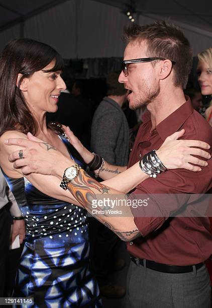 """Actress Perrey Reeves and photographer Randall Slavin attend Charlize Theron Africa Outreach Projects premiere of Randall Slavin's """"Reach: 24..."""
