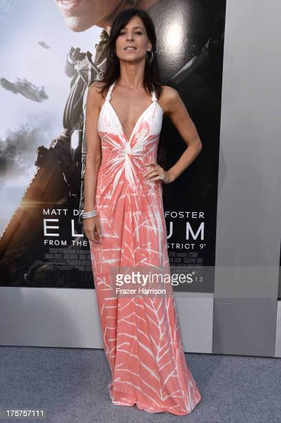 Actress Perrey Reeves arrives at the premiere of TriStar Pictures' Elysium at Regency Village Theatre on August 7 2013 in Westwood California