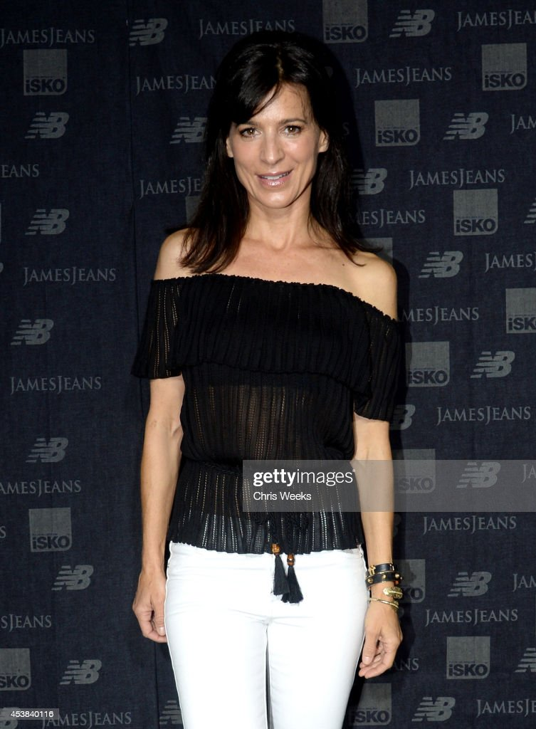 Actress Perrey Reeves attends a dance party with New Balance and James Jeans powered by ISKO at the home of Pascal Mouwad on August 19, 2014 in Bel Air, California.