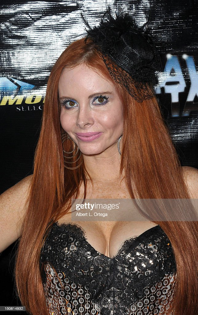 Actress Phoebe Price arrives for Heavy Metal Magazine's 35th Anniversary Party - Day 1 of Comic-Con International 2012 held at The Haunted Hotel on Thursday July 12, 2012 in San Diego, California.