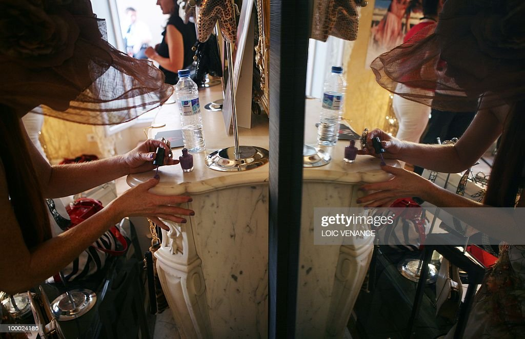 US actress Phoebe Price puts some nails polish as she prepares to walk on the red carpet at the 63rd Cannes Film Festival on May 20, 2010 in Cannes.