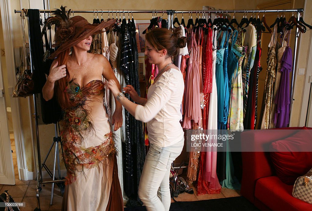 US actress Phoebe Price tries a dress designed by French Christophe Guillarme as she prepares to walk on the red carpet at the 63rd Cannes Film Festival on May 20, 2010 in Cannes.