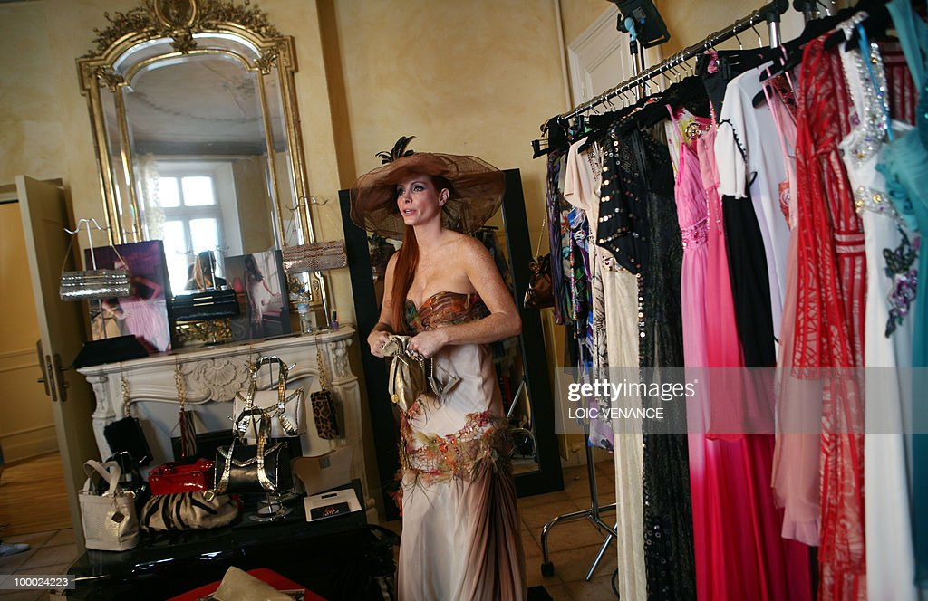 US actress Phoebe Price tries clothes designed by French designer Christophe Guillarme as she prepares to walk on the red carpet at the 63rd Cannes Film Festival on May 20, 2010 in Cannes.