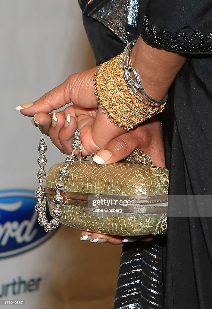 Actress Phylicia Rashad (jewelry and purse detail) attends the 11th annual Ford Neighborhood Awards at the MGM Grand Garden Arena on August 10, 2013 in Las Vegas, Nevada.