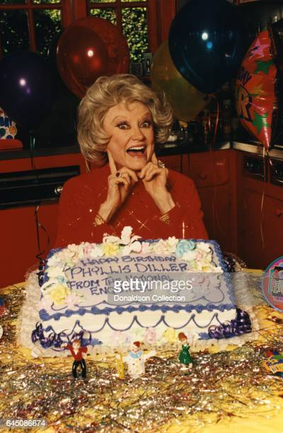 Actress Phyllis Diller poses for a portrait with her 79th birthday cake which reads Happy Birthday from the National Enquirer on July 17 1996 in Los...