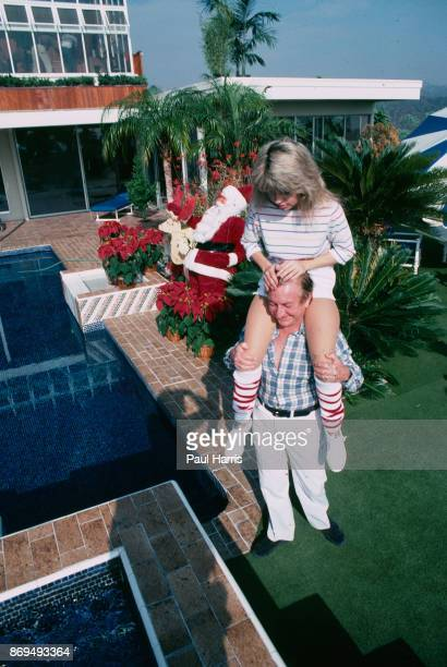 Actress Pia Zadora is carried by her husband multi millionaire Meshulum Riklis to the hot tub in the garden of their Beverly Hills home December 18...