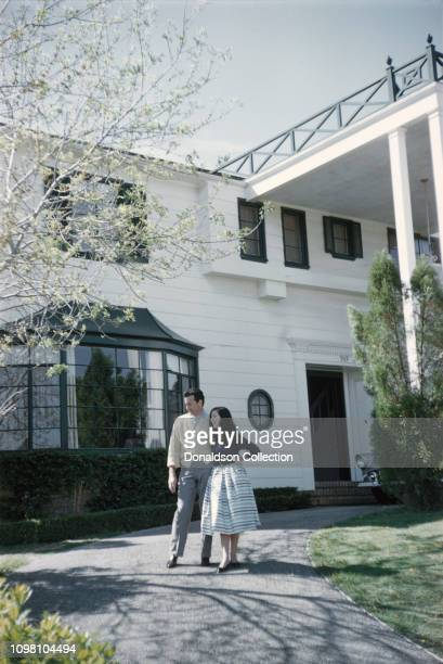 Actress Pier Angeli and husband singer Vic Damone pose for a portrait at home on March 15 1957 in Los Angeles California