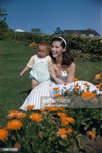 Actress Pier Angeli and son Perry pose for a portrait at home in 1956 in Los Angeles California