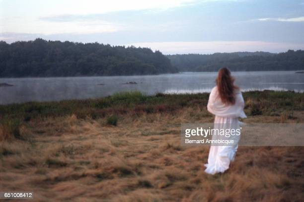 Actress playing the Fairy Viviane in front of Lake Comper where Merlin's crystal palace was