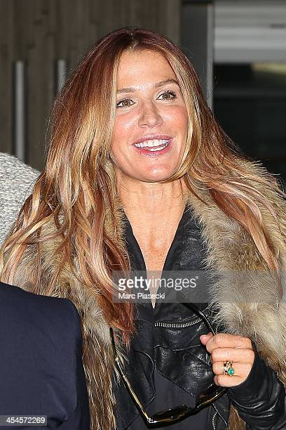 Actress Poppy Montgomery and Shawn Sanford arrive at CharlesdeGaulle airport on December 9 2013 in Paris France