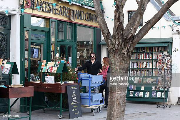 Actress Poppy Montgomery and Shawn Sanford enter the 'Shakespeare and Company' english bookstore on December 13 2013 in Paris France