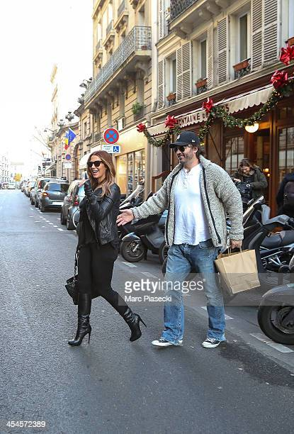 Actress Poppy Montgomery and Shawn Sanford leave the 'La Fontaine de Mars' restaurant on December 9 2013 in Paris France