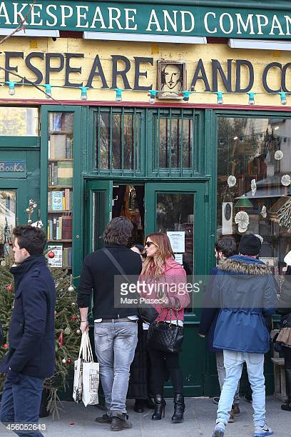 Actress Poppy Montgomery and Shawn Sanford leave the 'Shakespeare and Company' english bookstore on December 13 2013 in Paris France