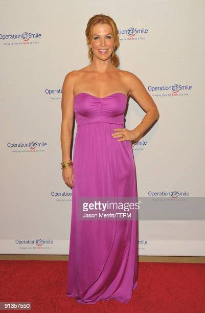 Actress Poppy Montgomery arrives at Operation Smile's 8th Annual Smile Gala at the Beverly Hills Hilton Hotel on October 2 2009 in Beverly Hills...