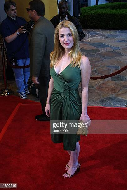 """Actress Poppy Montgomery arrives at the world premiere of the film """"Lara Croft: Tomb Raider"""" June 11, 2001 in Westwood, CA."""