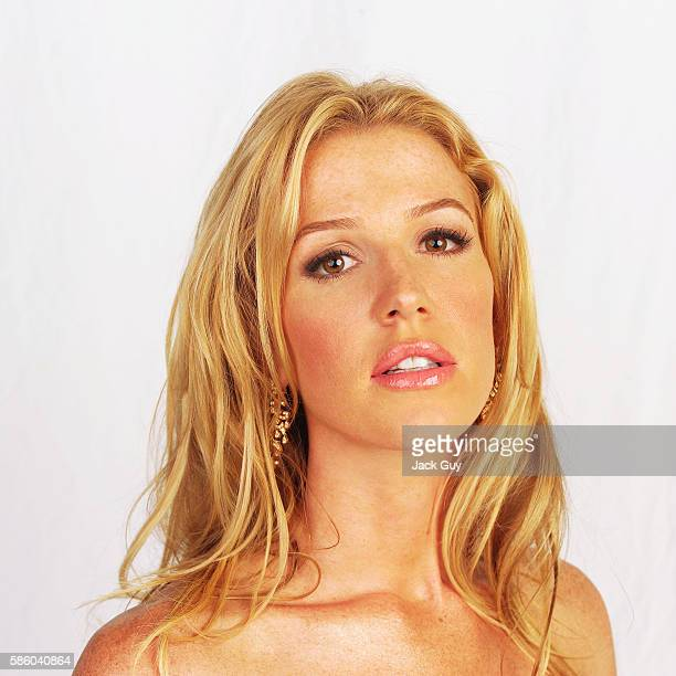 Actress Poppy Montgomery is photographed for Emmy Magazine at the 55th Annual Emmy Awards on September 21 2003 in Los Angeles California