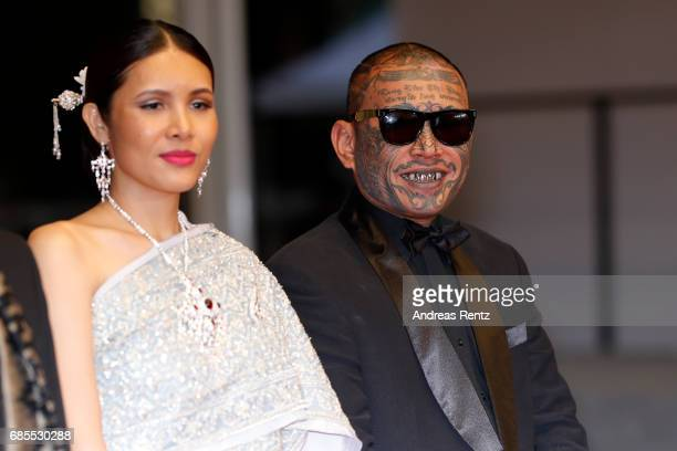Actress Pornchanok Mabklang and actor Panya Yimumpha attend the A Prayer Before Dawn screening during the 70th annual Cannes Film Festival at Palais...