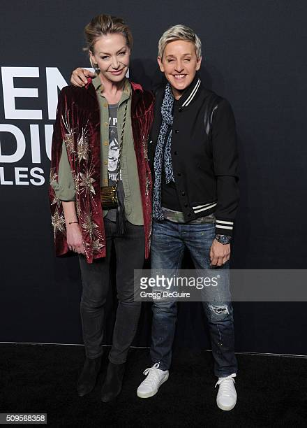 Actress Portia de Rossi and Ellen DeGeneres attend the Saint Laurent show at The Hollywood Palladium on February 10 2016 in Los Angeles California