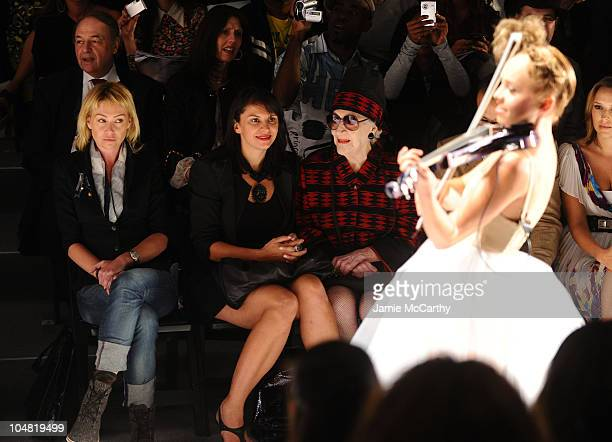 Actress Portia de Rossi and Zelda Kaplan watch electroviolinist Caitlin Moe perform on the runway at the Richie Rich Spring 2011 fashion show during...