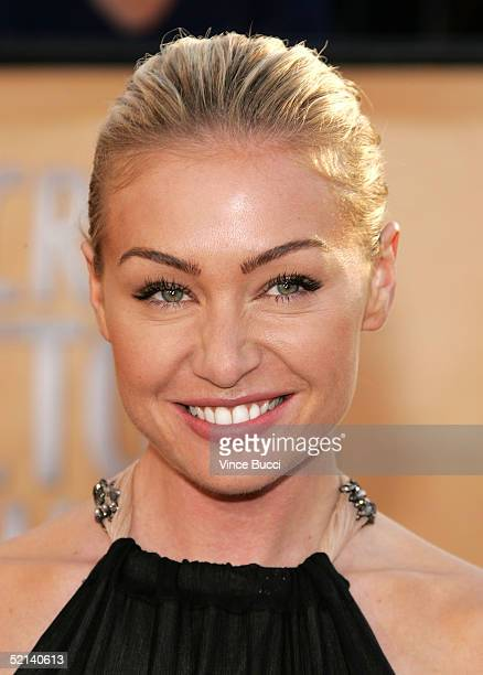 Actress Portia de Rossi arrives at the 11th Annual Screen Actors Guild Awards at the Shrine Exposition Center on February 5, 2005 in Los Angeles,...