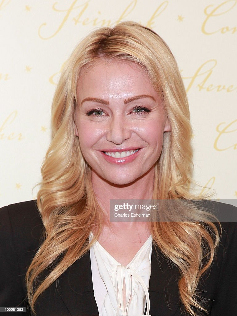 Portia De Rossi Signs Copies of